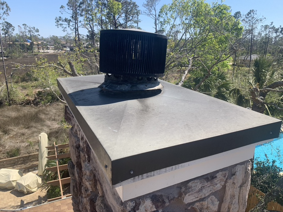 Sootaway installing a new chase cover and chimney cap in Daphne