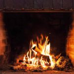 burning fire in newly repaired masonry fireplace